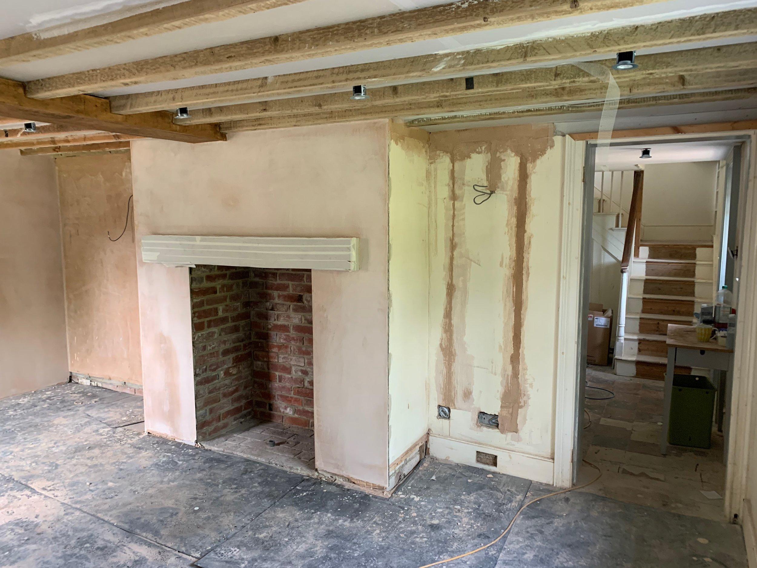 Front room plastering is in-progress