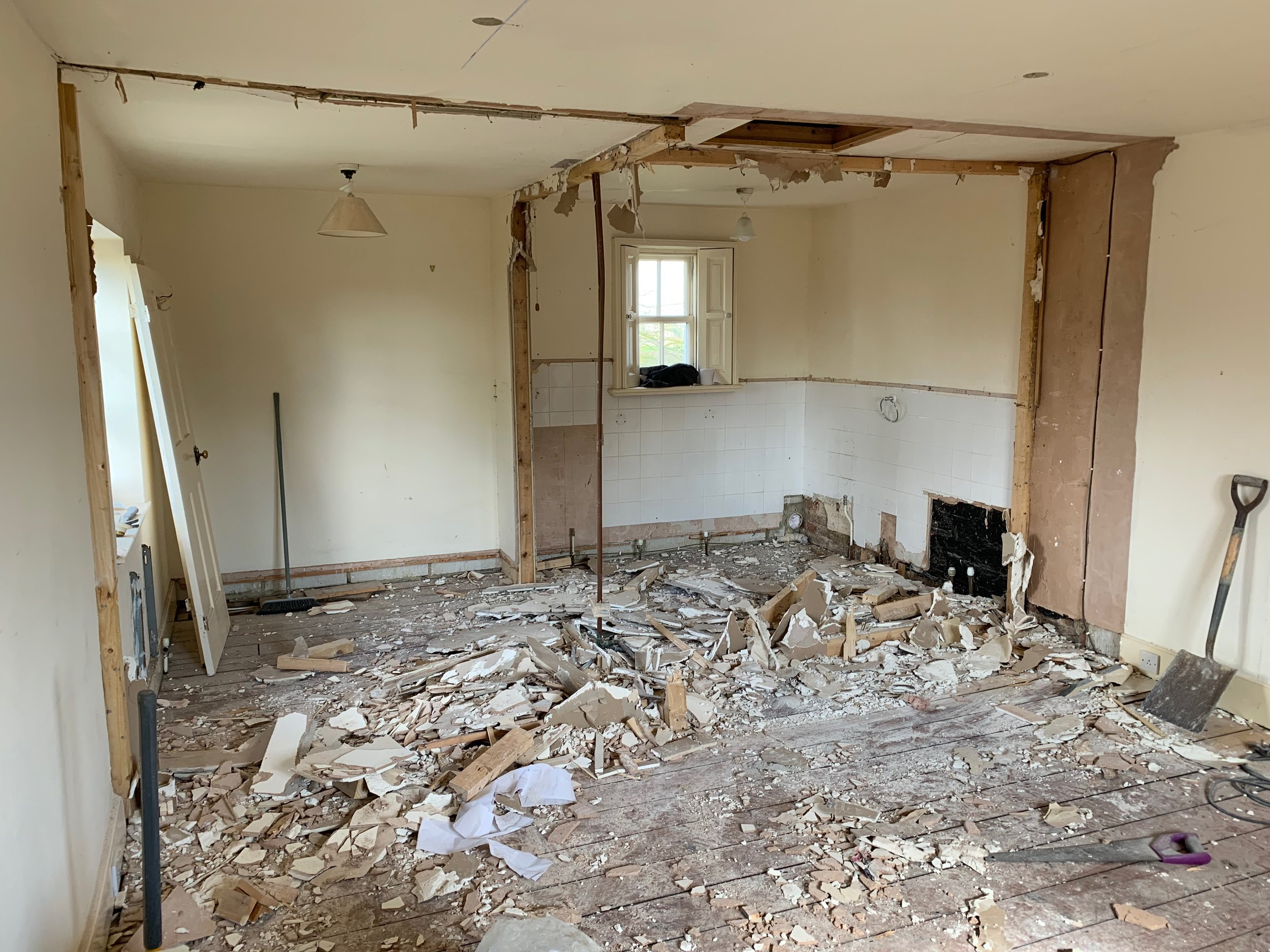 Reconfiguring the layout of the master bedroom to create an en-suite.