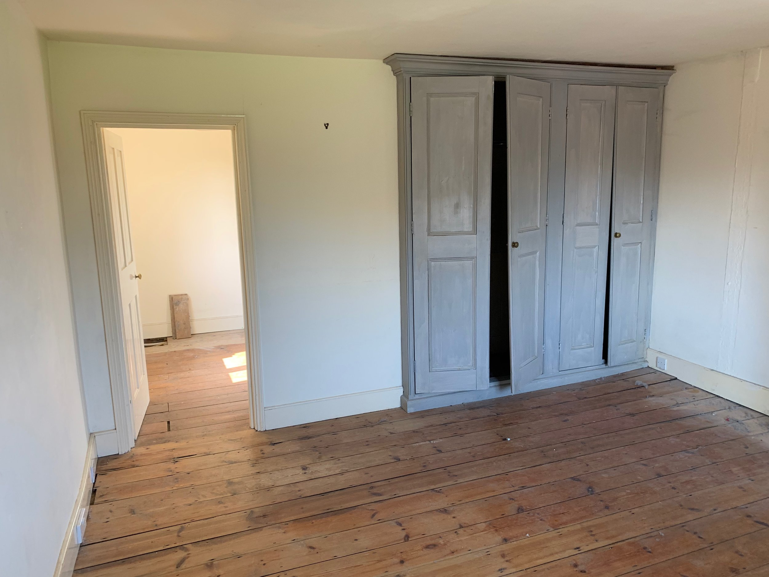 This is the Master Bedroom before the partition wall to the bathroom is taken down.