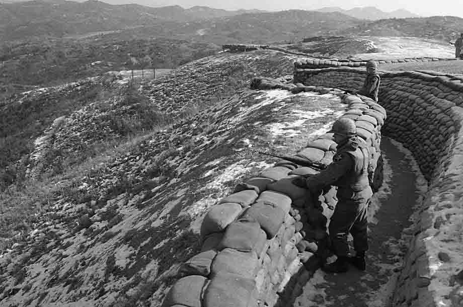 American soldiers keep watch for North Korean troop activity from a trench along the southern side of the DMZ, Feb. 8, 1968. (AP Photo)