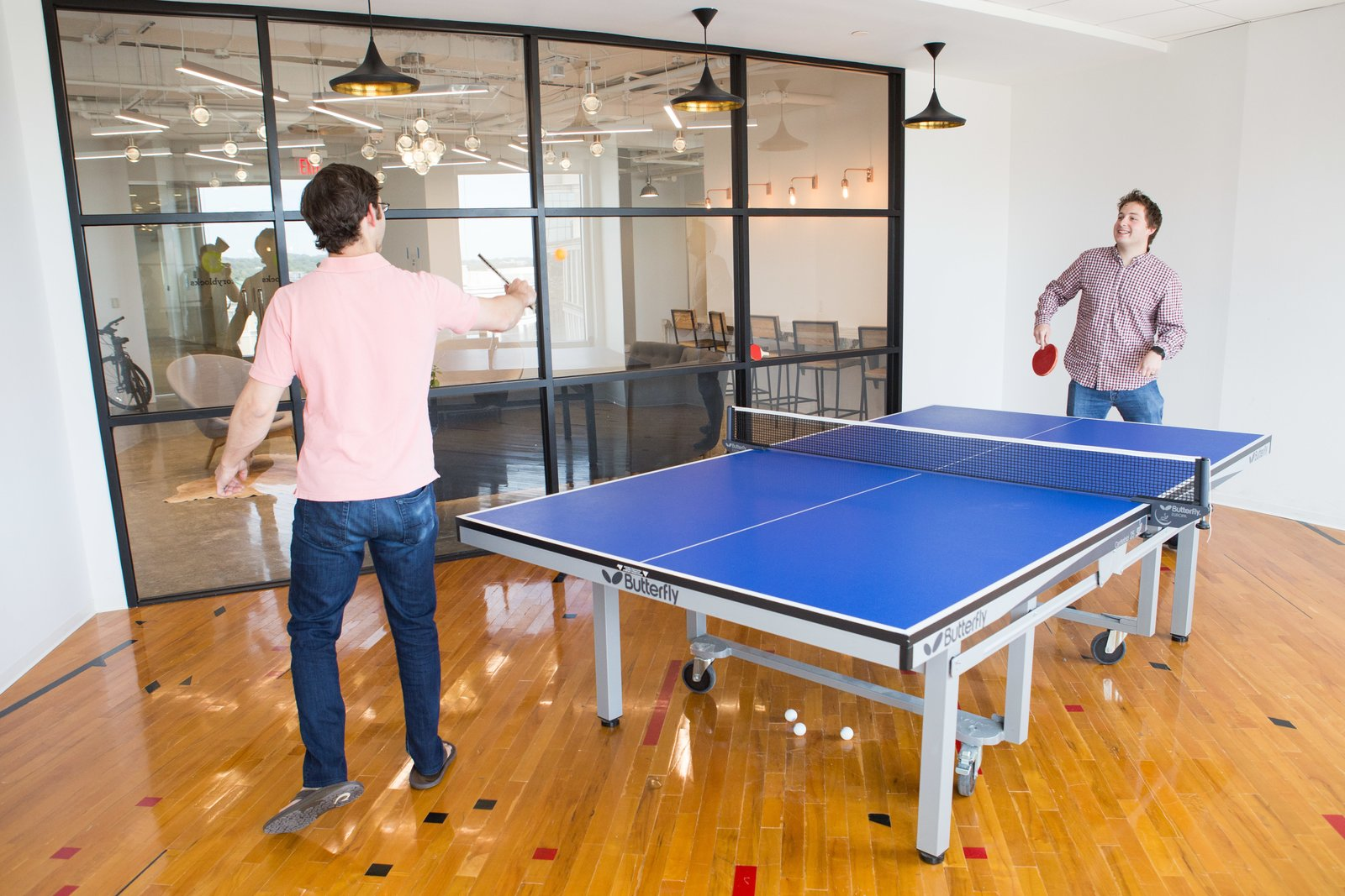 ping-pong-room-with-authentic-wood-gym-flooring.jpg