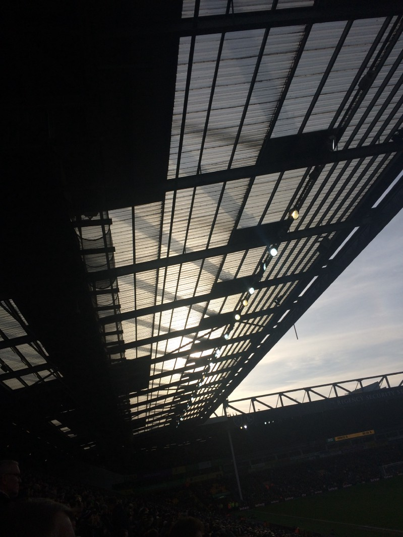 Second-half sun through the South Stand roof.