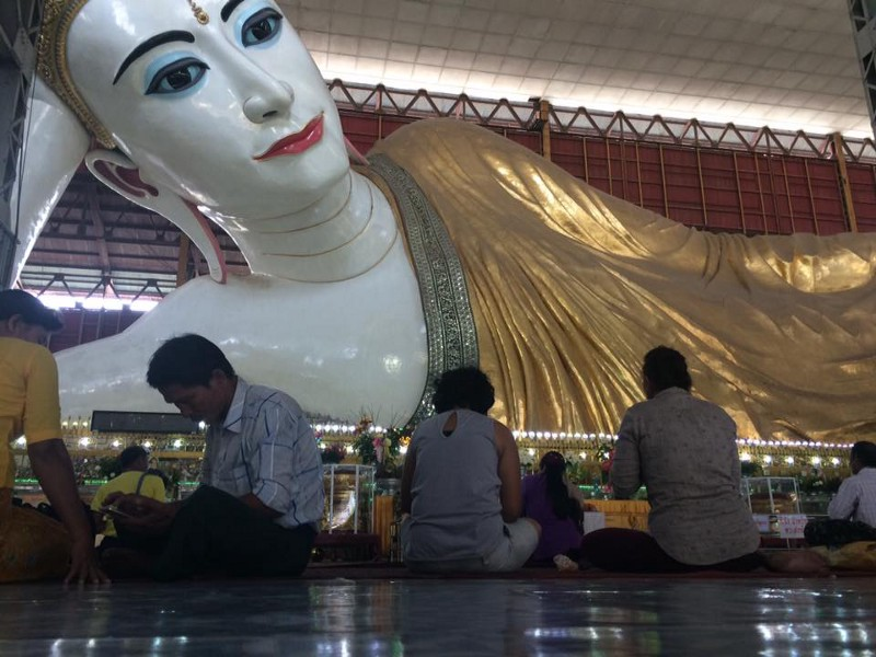 200ft reclining Buddha at the Chauk Htet Gyi temple. The bloke in the white shirt was checking his Facebook.