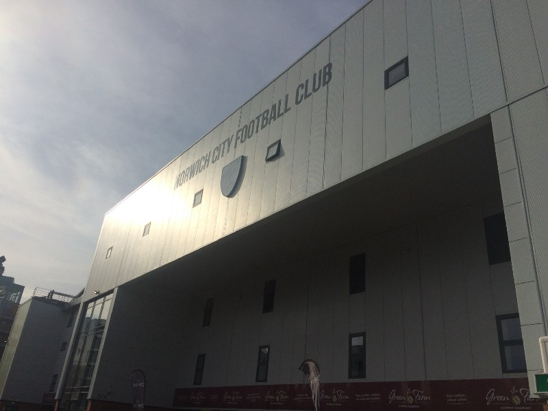 The South Stand edifice: even the club's bright-yellow badge is rendered colourless.