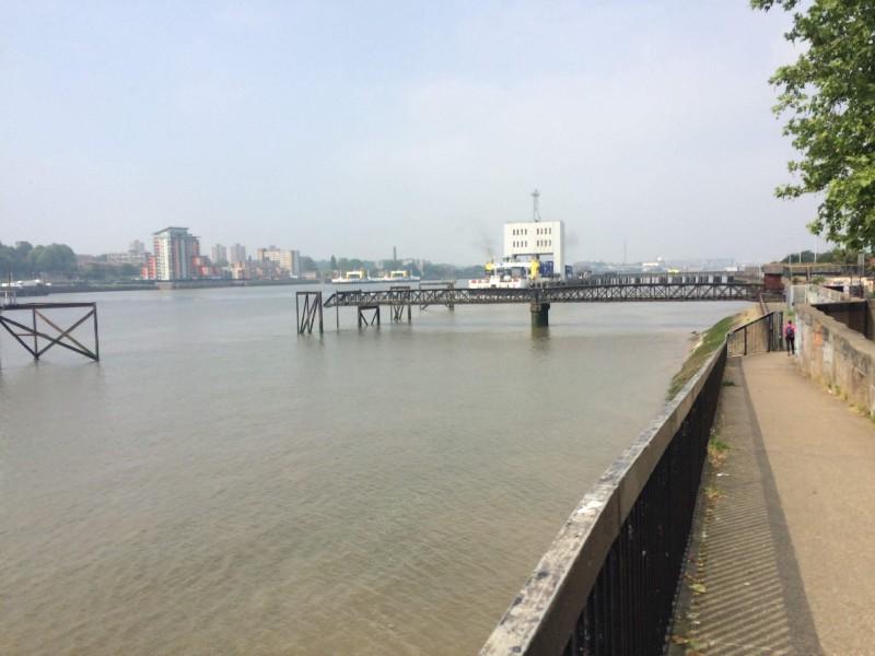 The modern ferry hides behind the iron Victorian pier.