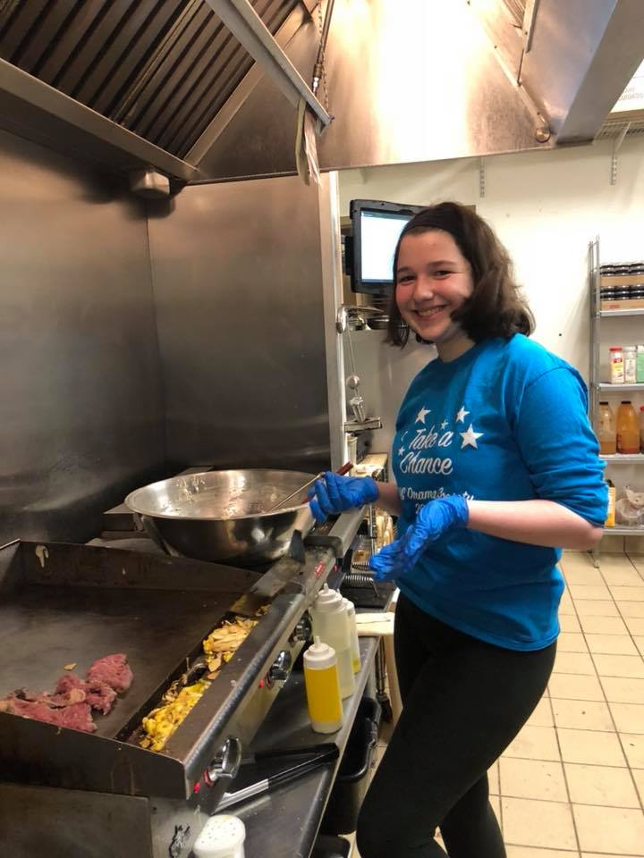 Rachel helping out in the kitchen during a Hudson High School Drama Club breakfast.