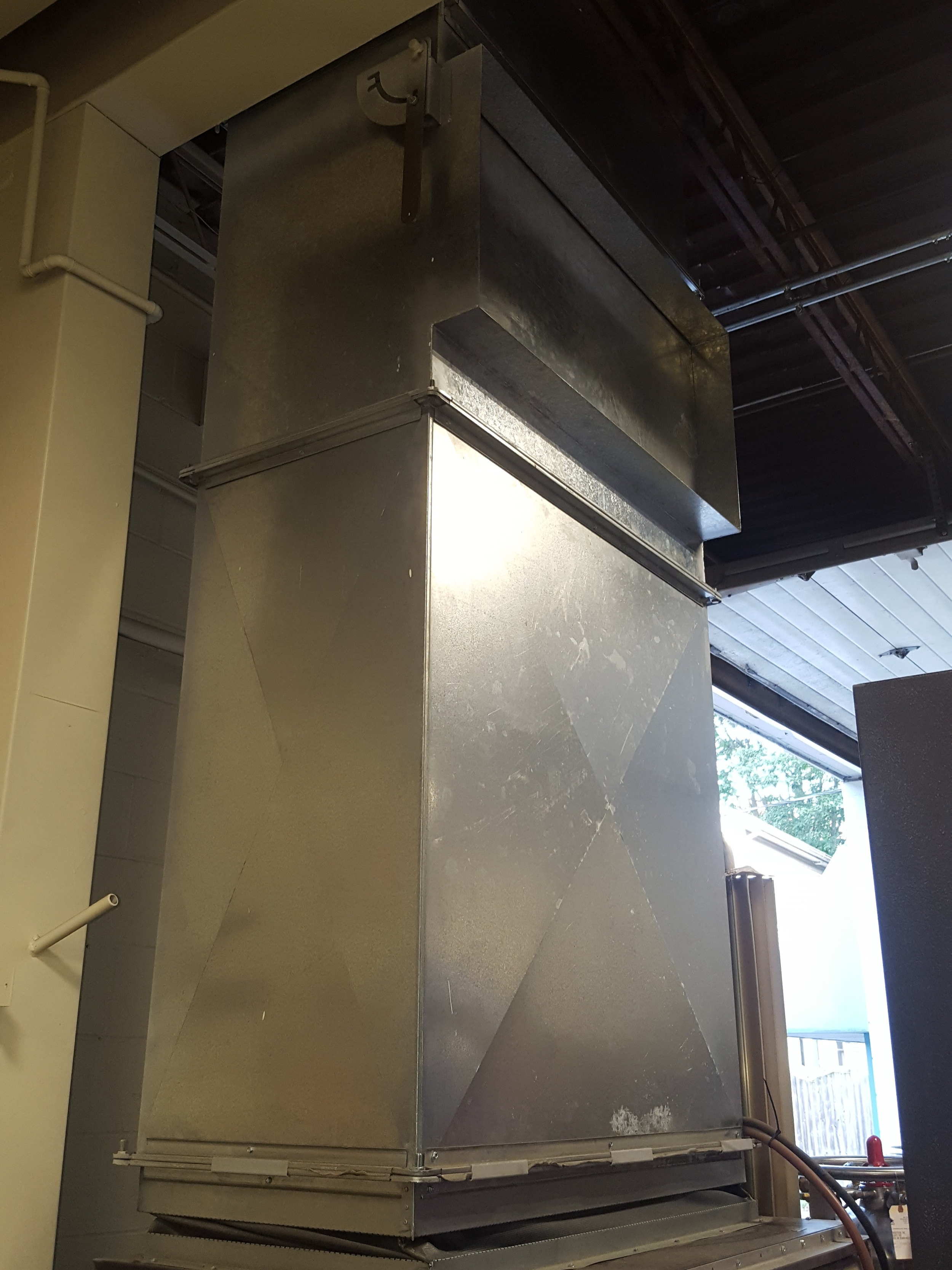 Custom exhaust duct work to carry chiller system heat out of the building in the summer and inside in the winter.