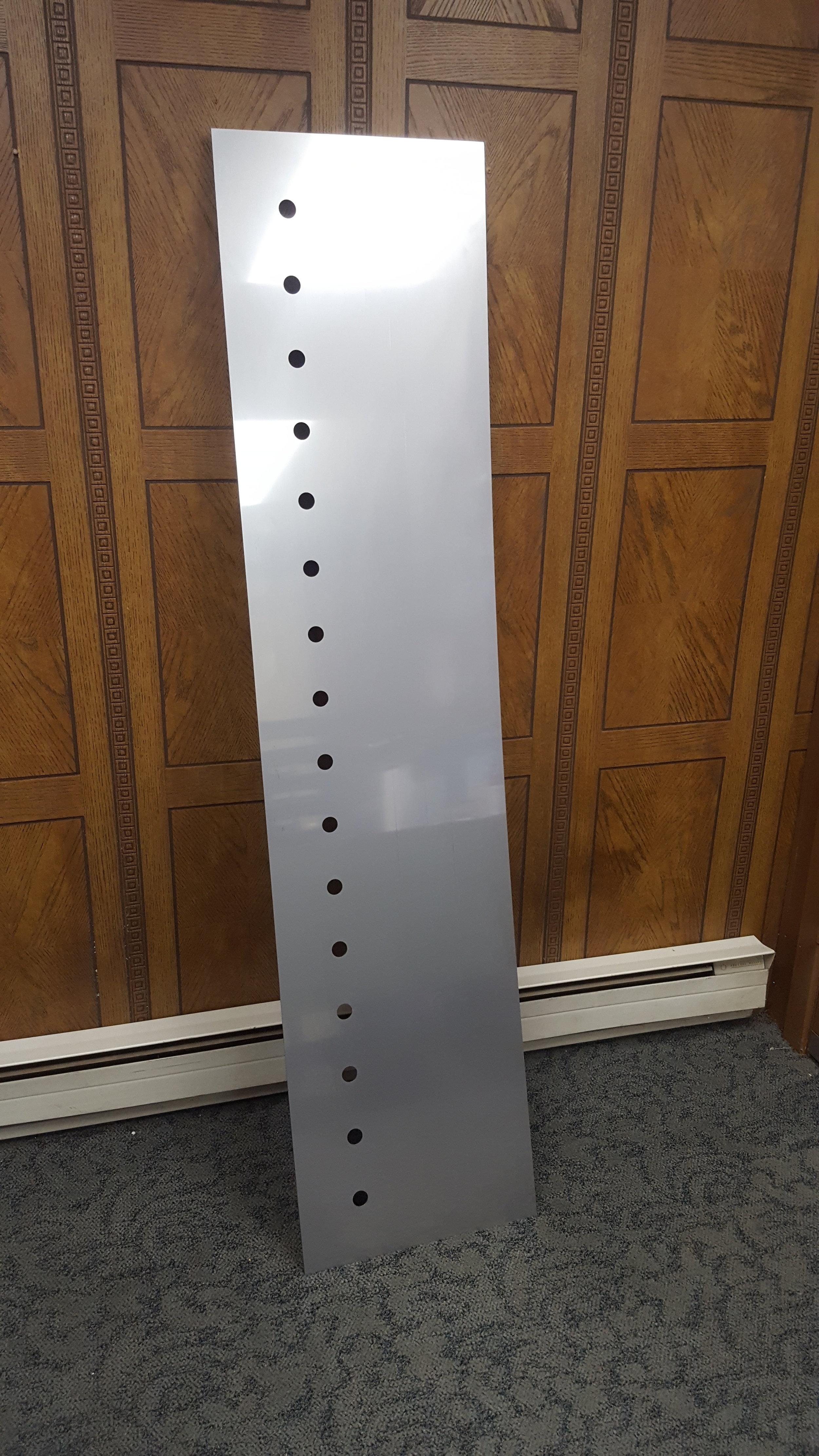 A laser cut bar backsplash, made from 11 gauge stainless steel.