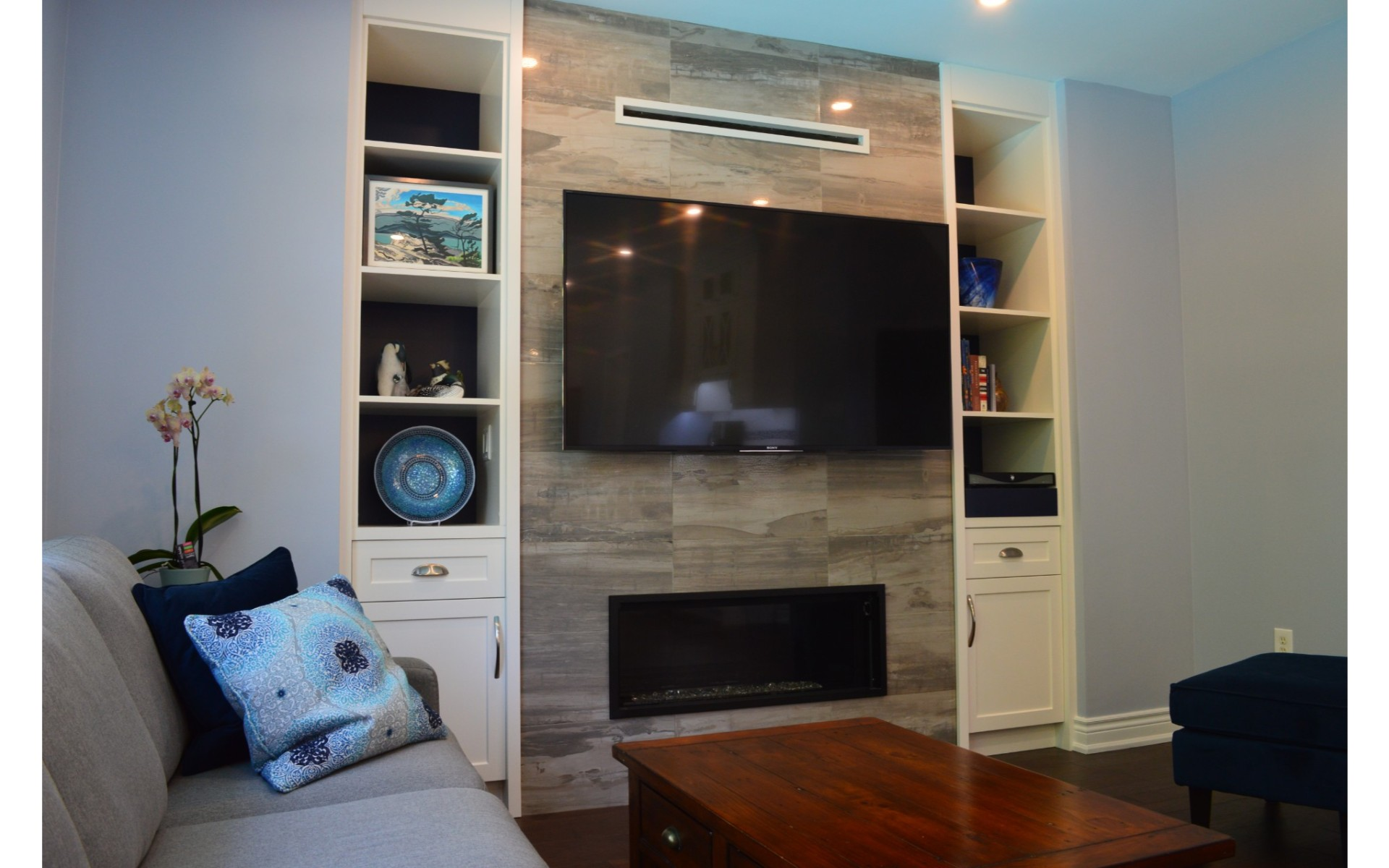 Entertainment centre with TV mounted over fireplace