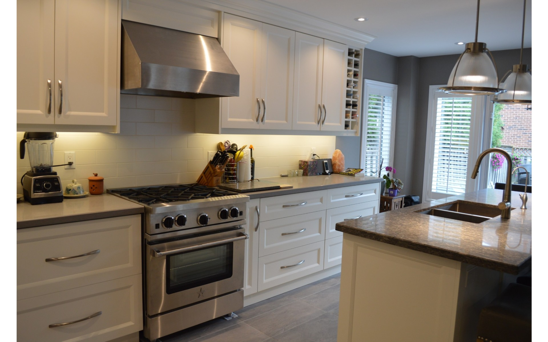 Kitchen with stainless steel appliances and white cabinets