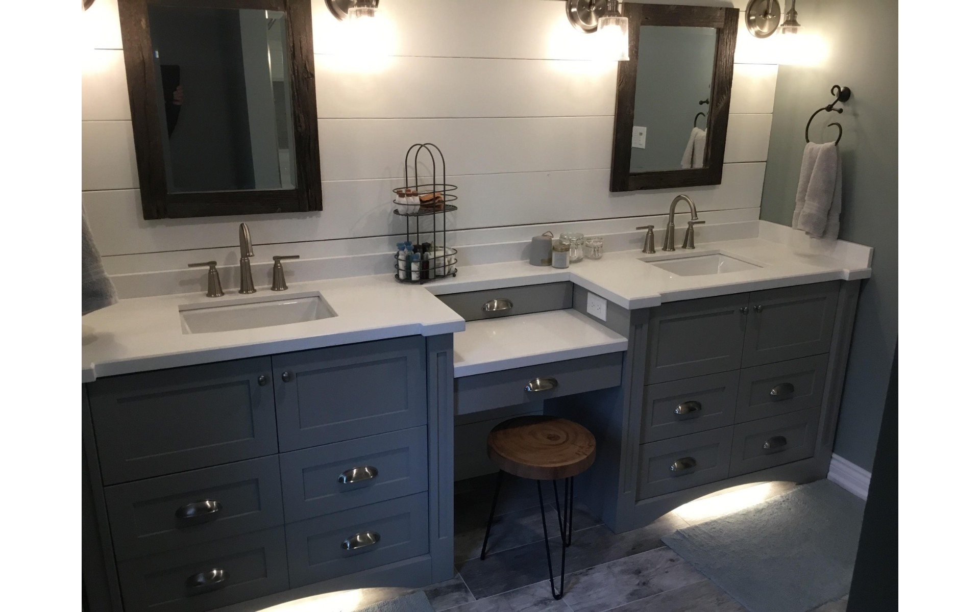 Powder room with double vanity, blue cabinets and white counters