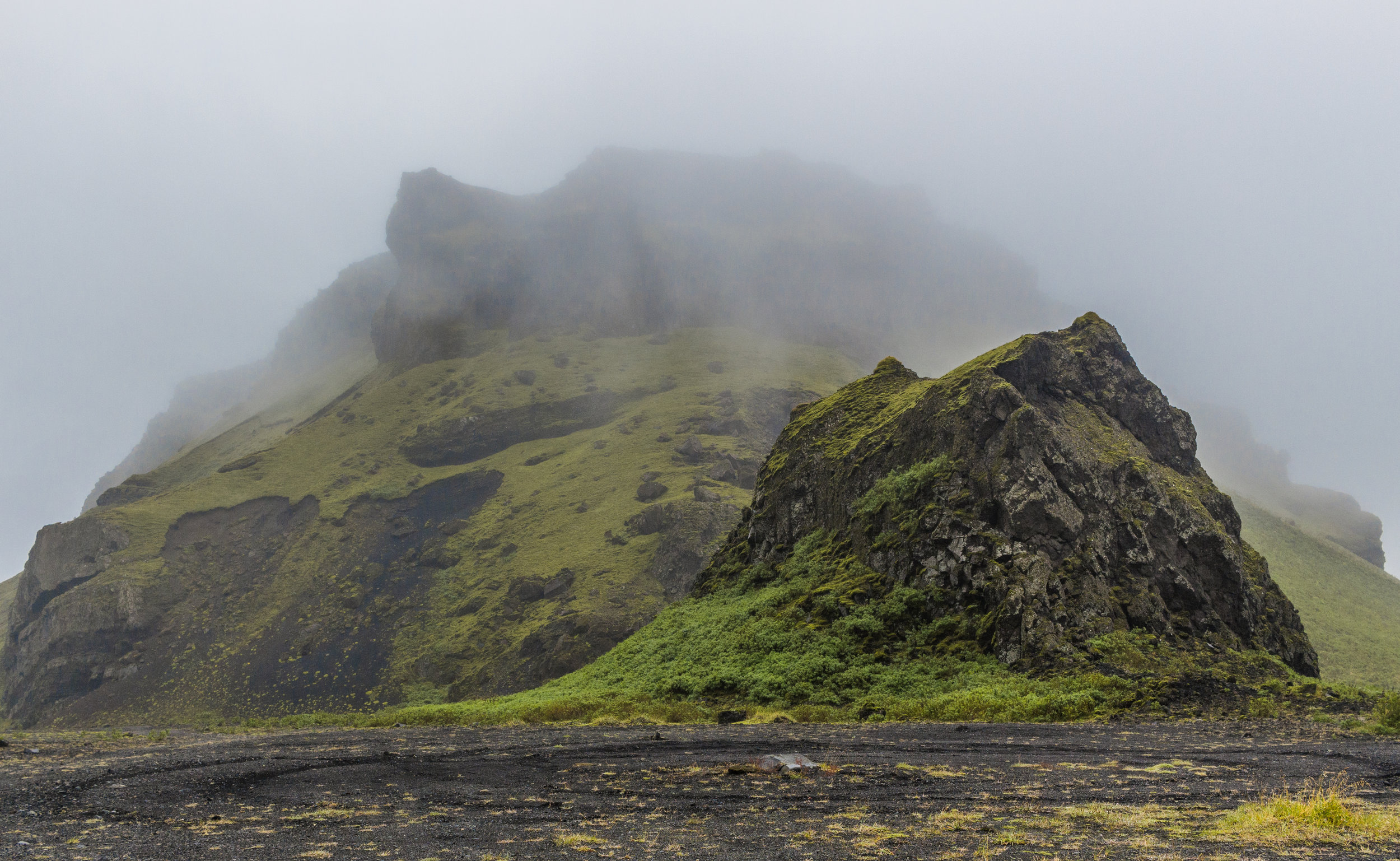 Fog rolling in over the black sand beach