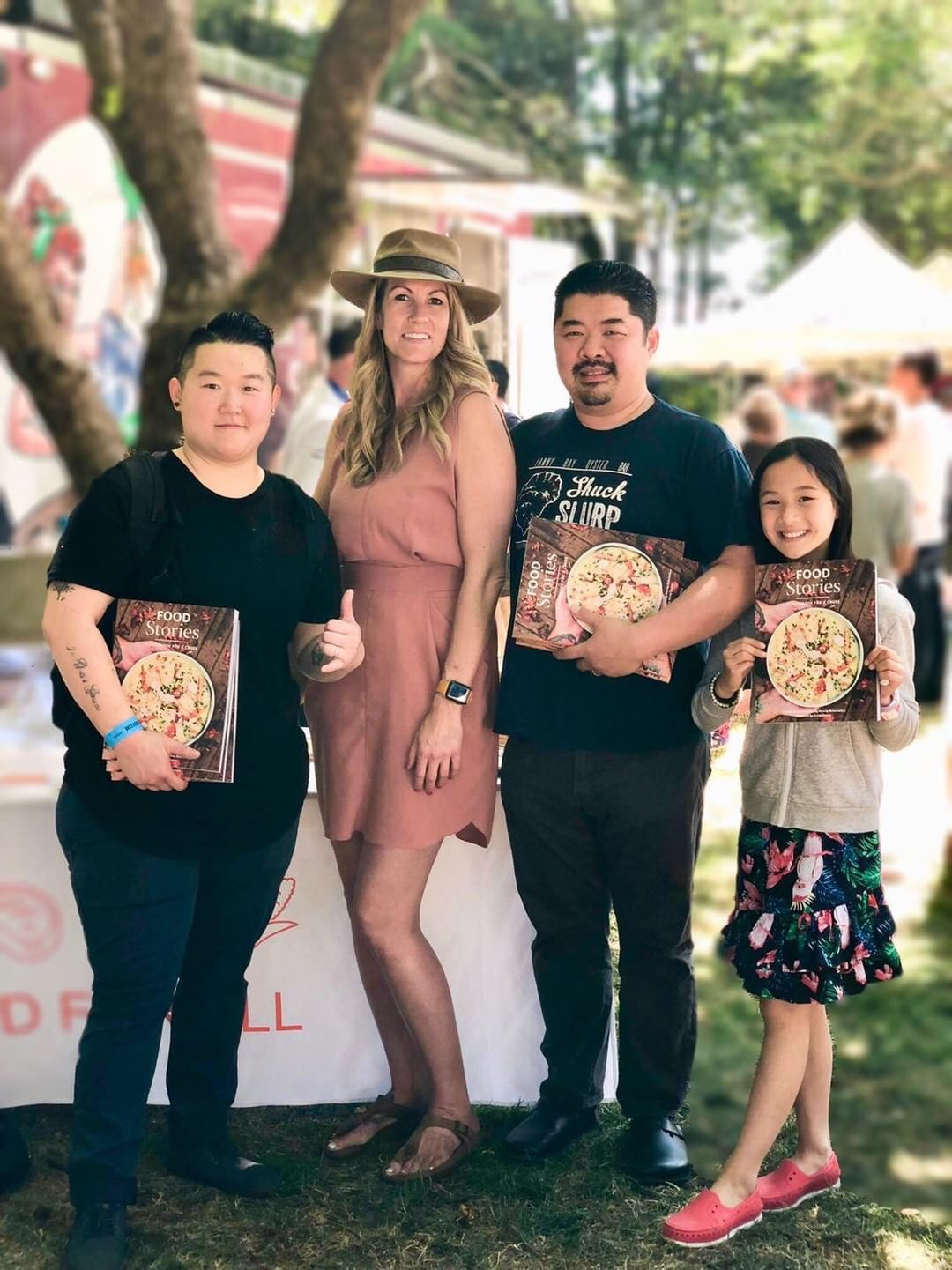 Chef Eva Chin, (left) Food For All CEO Jenn Coe (center) and Chef Alex Chen enjoying the BC Seafood Festival with his daughter. (right)