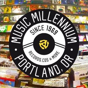 Music Millennium - It was The Ides of March, March 15th of 1969, when Don MacLeod, his wife Loreen and brother in law Dan Lissy first opened an 800 square foot record store on the corner of 32nd & East Burnside. Specializing in mostly underground music not found in the department stores, drugstores or the couple of record stores which existed at the time, Music Millennium filled a niche for the Portland music community.Titles by Fairport Convention, Frank Zappa, John Fahey, The Fugs and Holy Modal Rounders were stocked in the small store along with the sounds heard on the then three month old FM station, KINK- The Underground Link.The store quickly grew in the first five years to its current size, including the addition of a classical store called The Musical Offering, later known as Classical Millennium (closed in 2012). A second Music Millennium store was also added next to the now defunct Purple Earth Tavern at NW 21st & Irving, later located at 23rd & Johnson.It's over 40 years later and Music Millennium is the oldest record store in existence in the Pacific Northwest. Throughout our history, we've stocked the ever-evolving gamut of formats including LP, 45, reel-to-reel, 8-track, cassette, DAT, compact disc, mini-disc, DCC and CD-ROM.As people who know and love music, Music Millennium has hosted an array of in-store performances and autograph appearances over the years, including the likes of Richard Thompson, Luscious Jackson, Loreena McKennitt, Maureen McCormick (aka