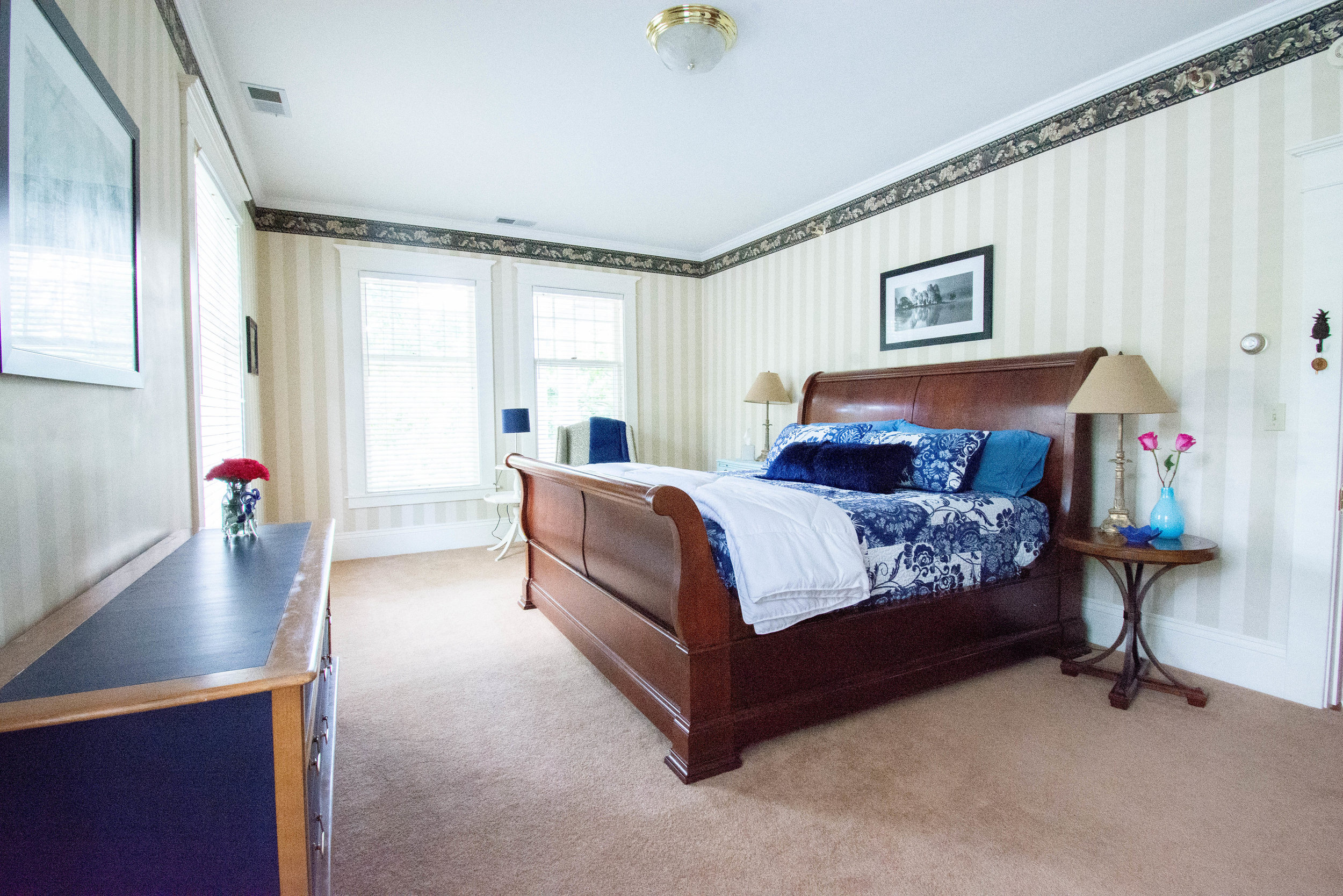 "<img alt= ""full room view of room from right side of bed including dresser and nightstand"" />"