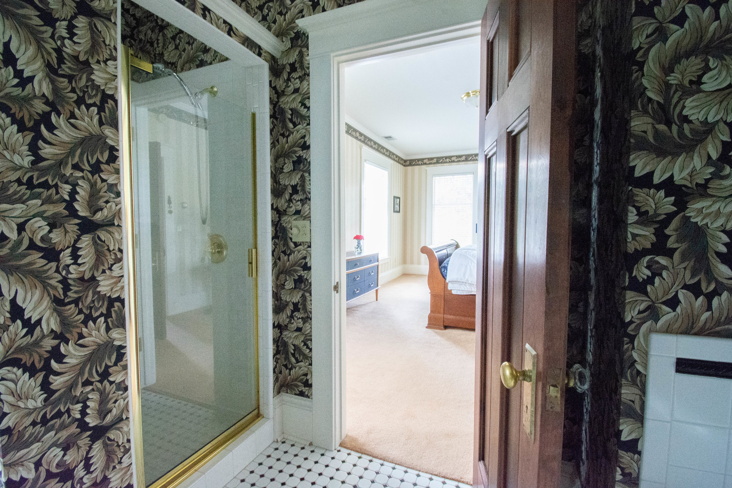 "<img alt= ""Bathroom view with shower and view into Blue Ram room"" />"