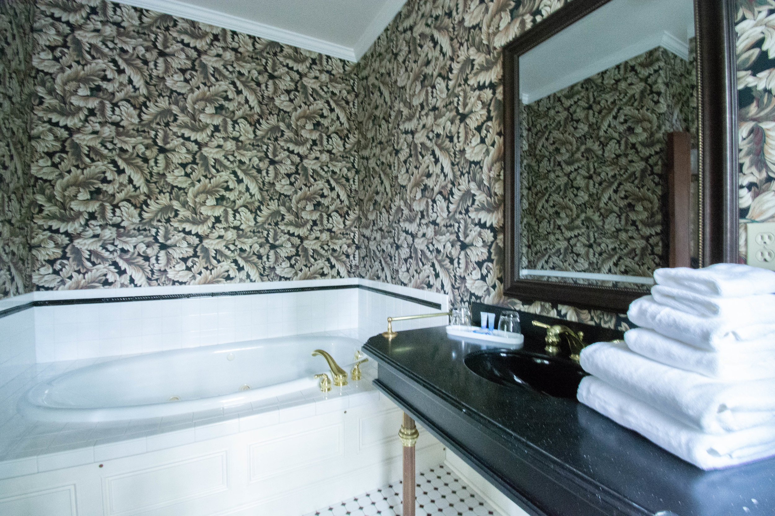 "<img alt= ""bathroom view of jetted tub and sink"" />"