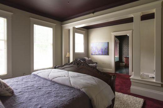 "alt=""Purple Viking Room looking into bathroom from head of bed"""