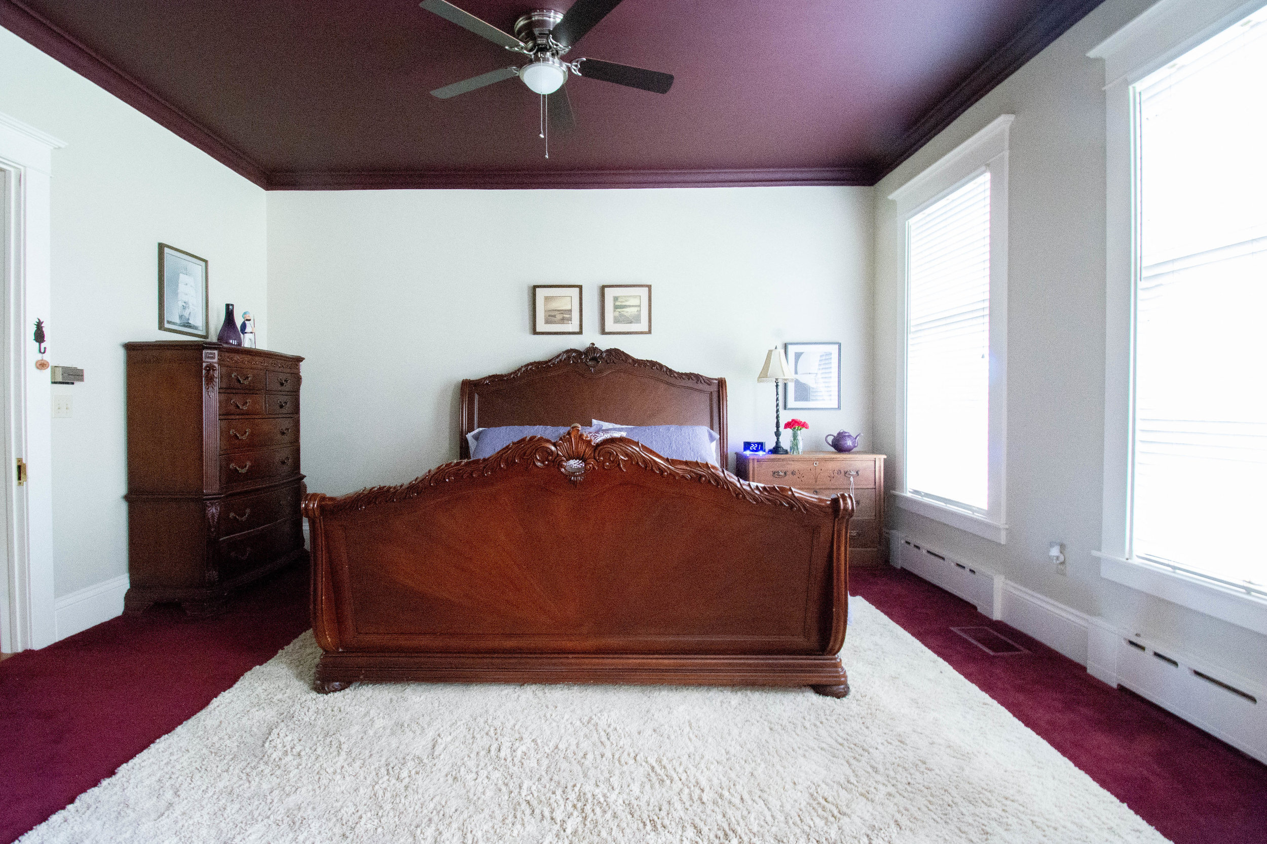 """alt=""""Purple Viking room looking at bed, night stands and dresser from the foot of the bed"""""""