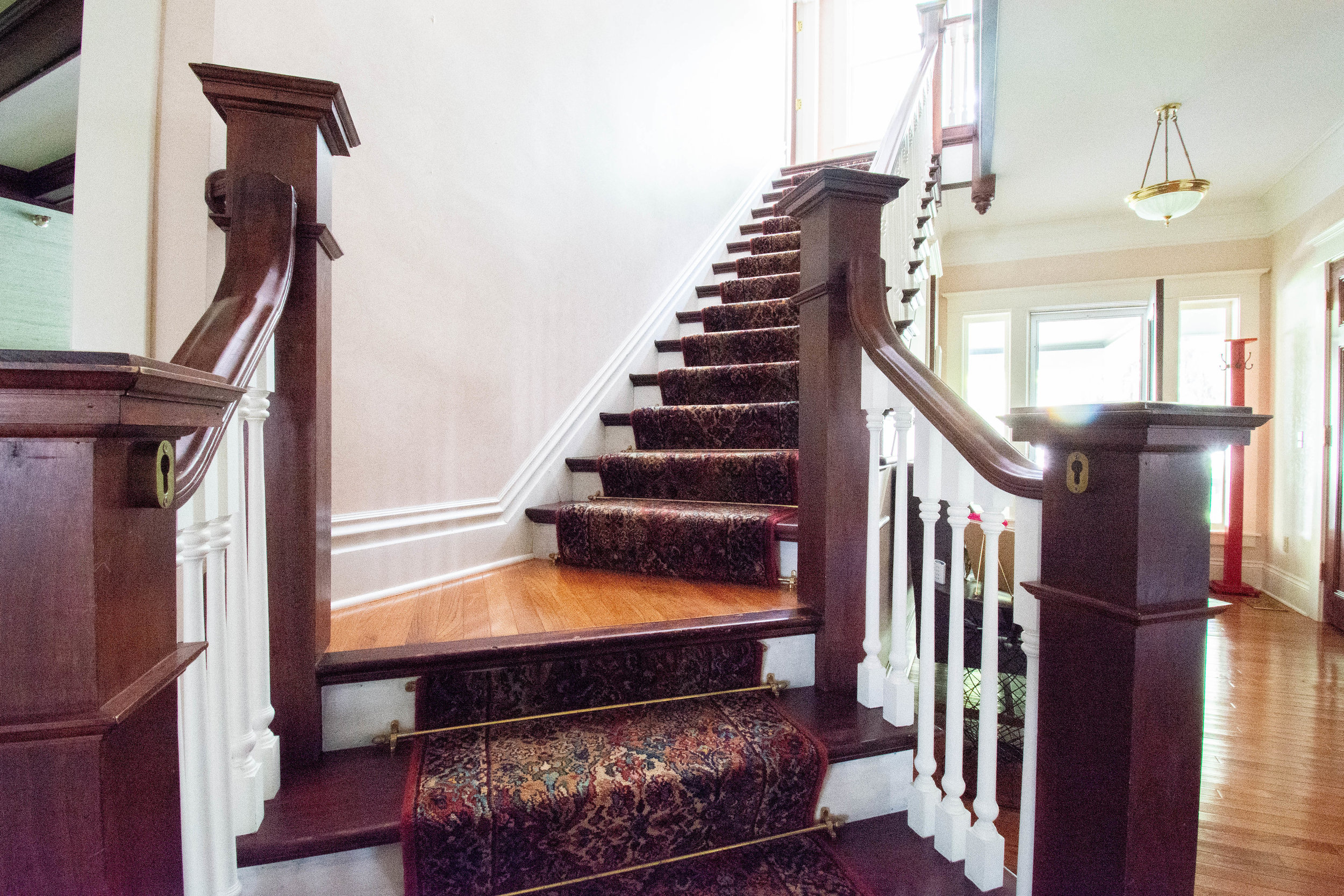 "<img alt= ""Fron hall stairs"" />"