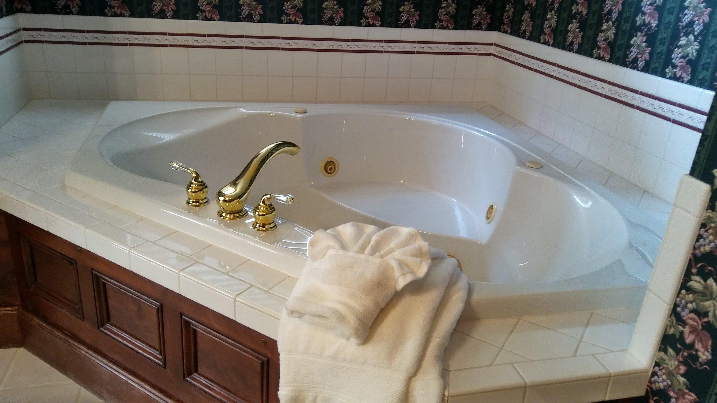 "alt=""Corner jetted tub in Green duck bathroom"""