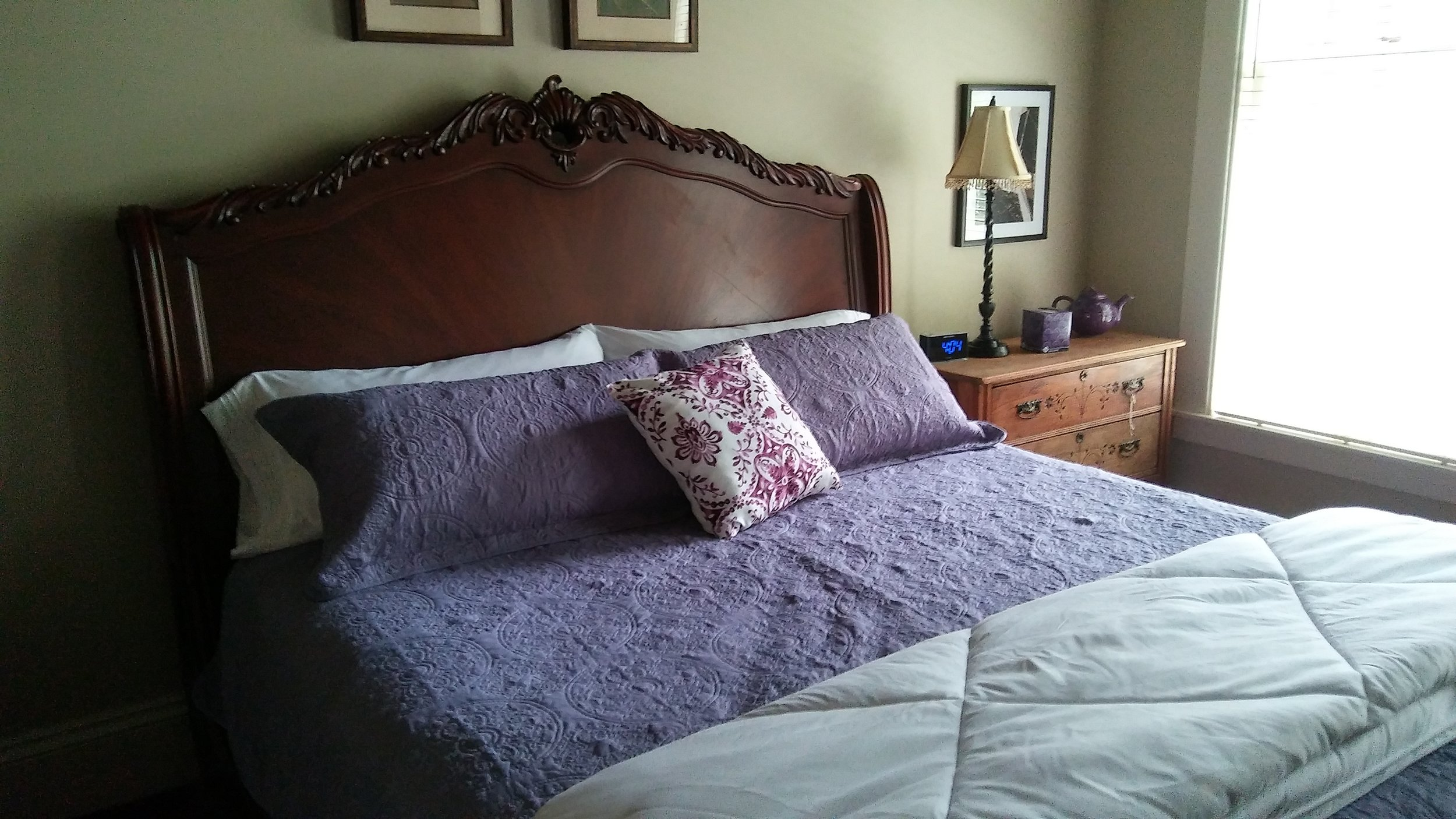 the purple viking - King Suite: $169/nightEnjoy this first-floor suite with easy access to all the inn has to offer, including the lawn and relaxing wrap around porch. The ornate king-sized mahogany sleigh bed is the focal point of this large room. There is a reading nook with a cozy love seat perfect for that quick catnap before heading out for a quiet dinner. The private attached bath offers a separate shower as well as a large jetted tub.