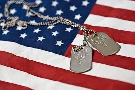 "<img alt= ""U.S. flag with dogtags"" />"