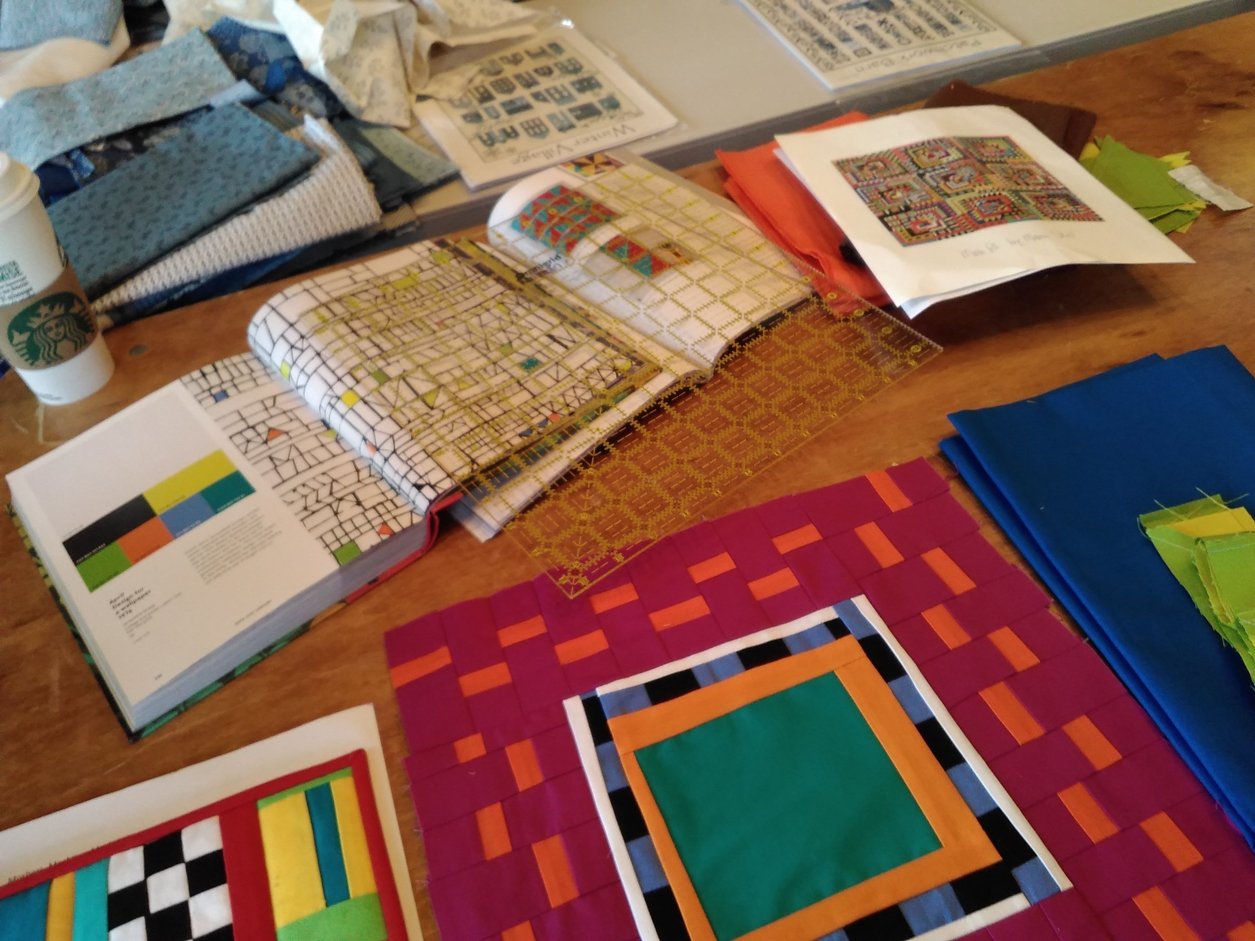 "<img alt= ""Craft books and quilting squares"" />"