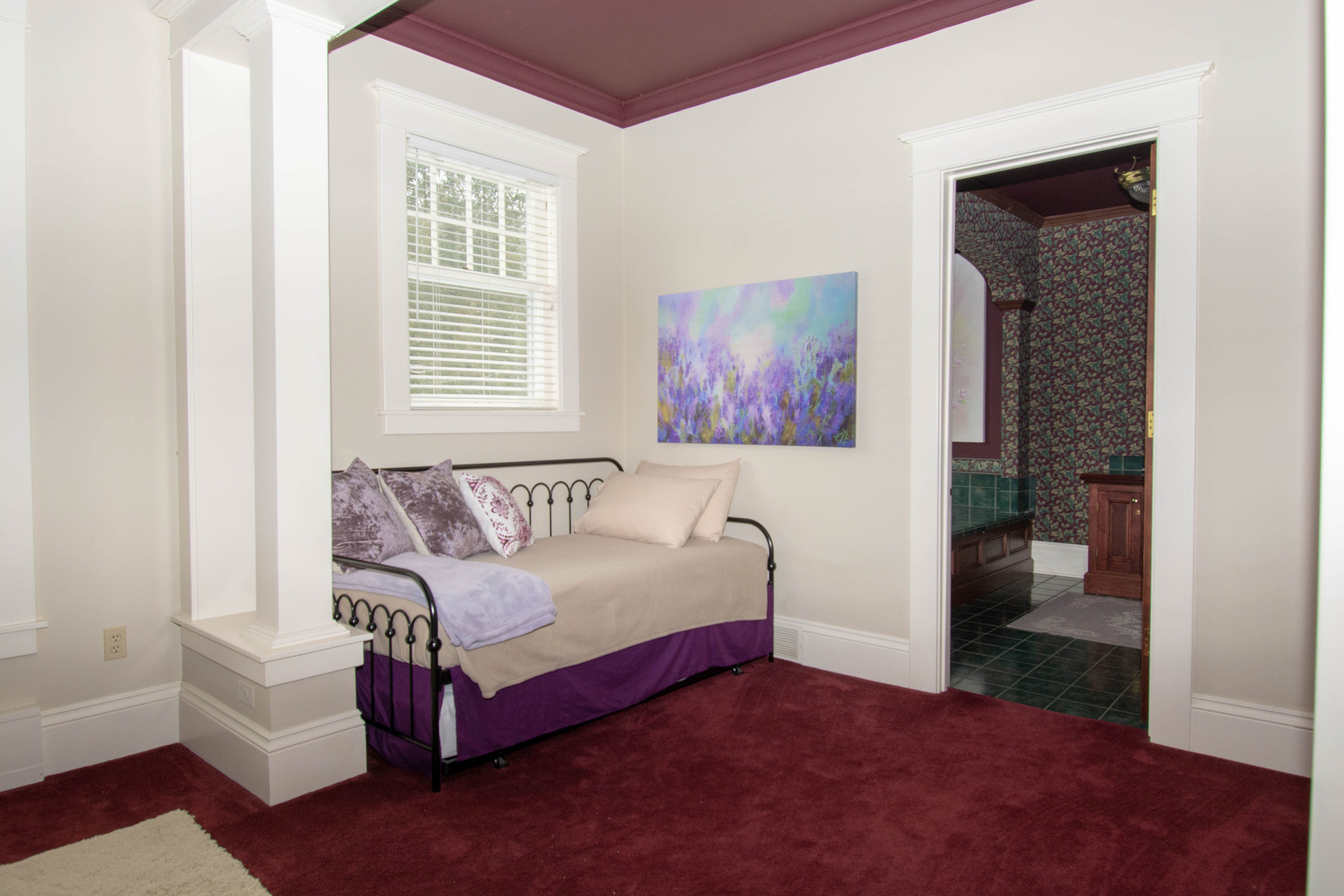 """alt=""""Daybed in Purple Viking room"""""""