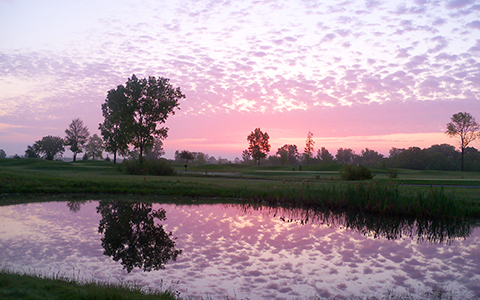 "alt=""Sunrise over pond and fairway at The Emerald Golf Course"""