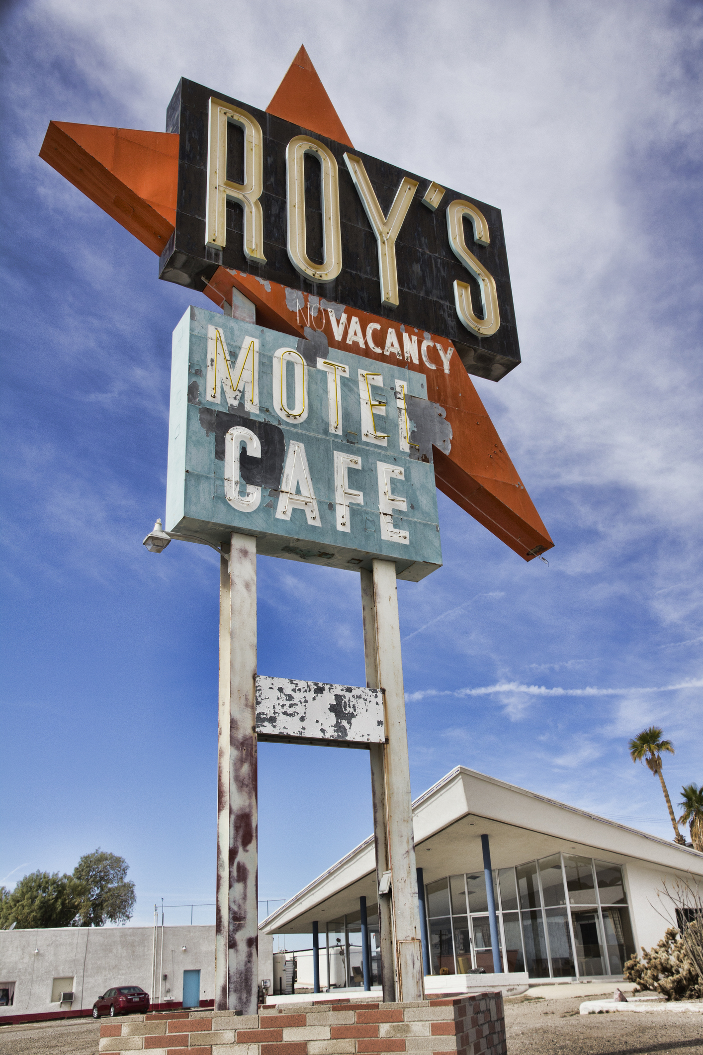 "In 1959, the 50 ft tall, neon, Roy's sign was erected, making the town of Amboy visible for miles and became the ""must see"" attraction to all visitors.  The sign's neon tubing is currently being restored and will be repainted afterwords. Amboy plans to throw a public event to showcase the relighting of our famous sign."