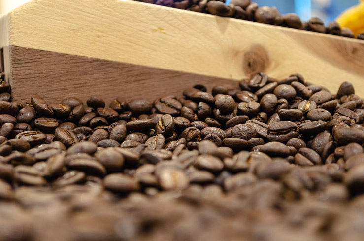 Medium-Roast-Coffee-Beans-Wood-Background.jpg