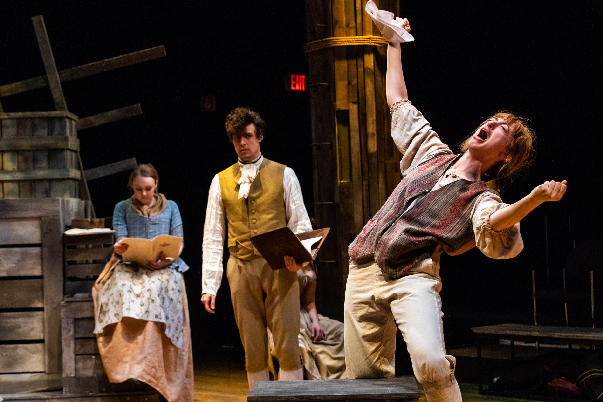 """Sideways, ( right ) played by actress Sarah Hirsch, dramatically performs the lines he has memorized in the first rehearsal for """"The Recruiting Officer."""" The director of this play-within-a-play, Ralph Clark  (center),  played by Julian Manjerico, looks on in horror."""