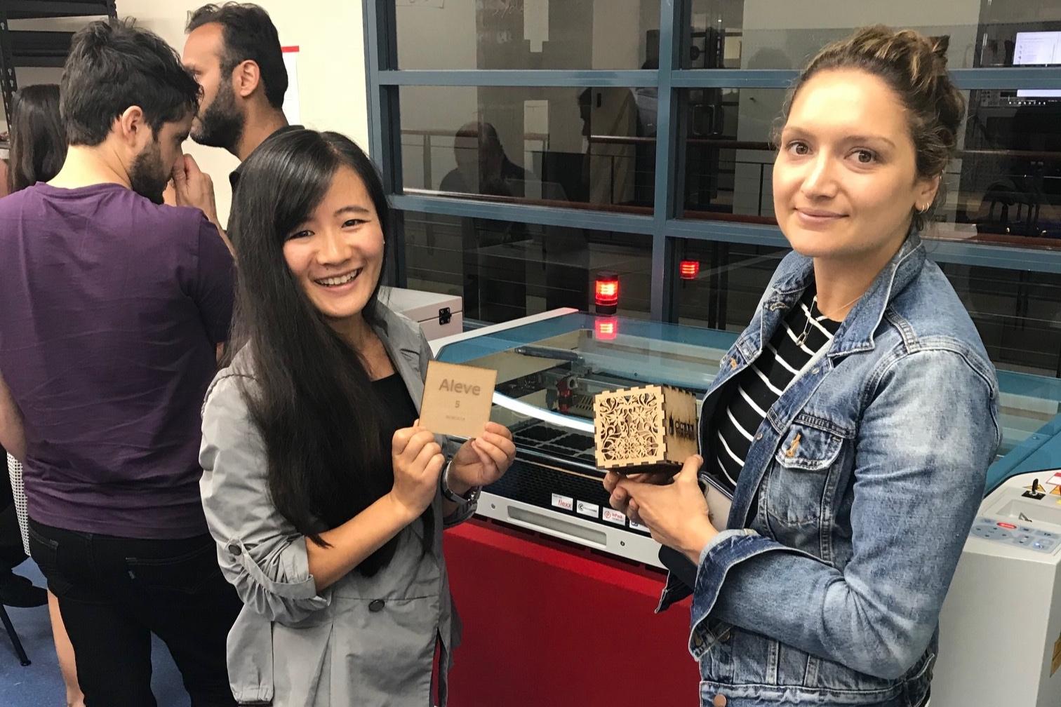 Girls showing laser cutting materials