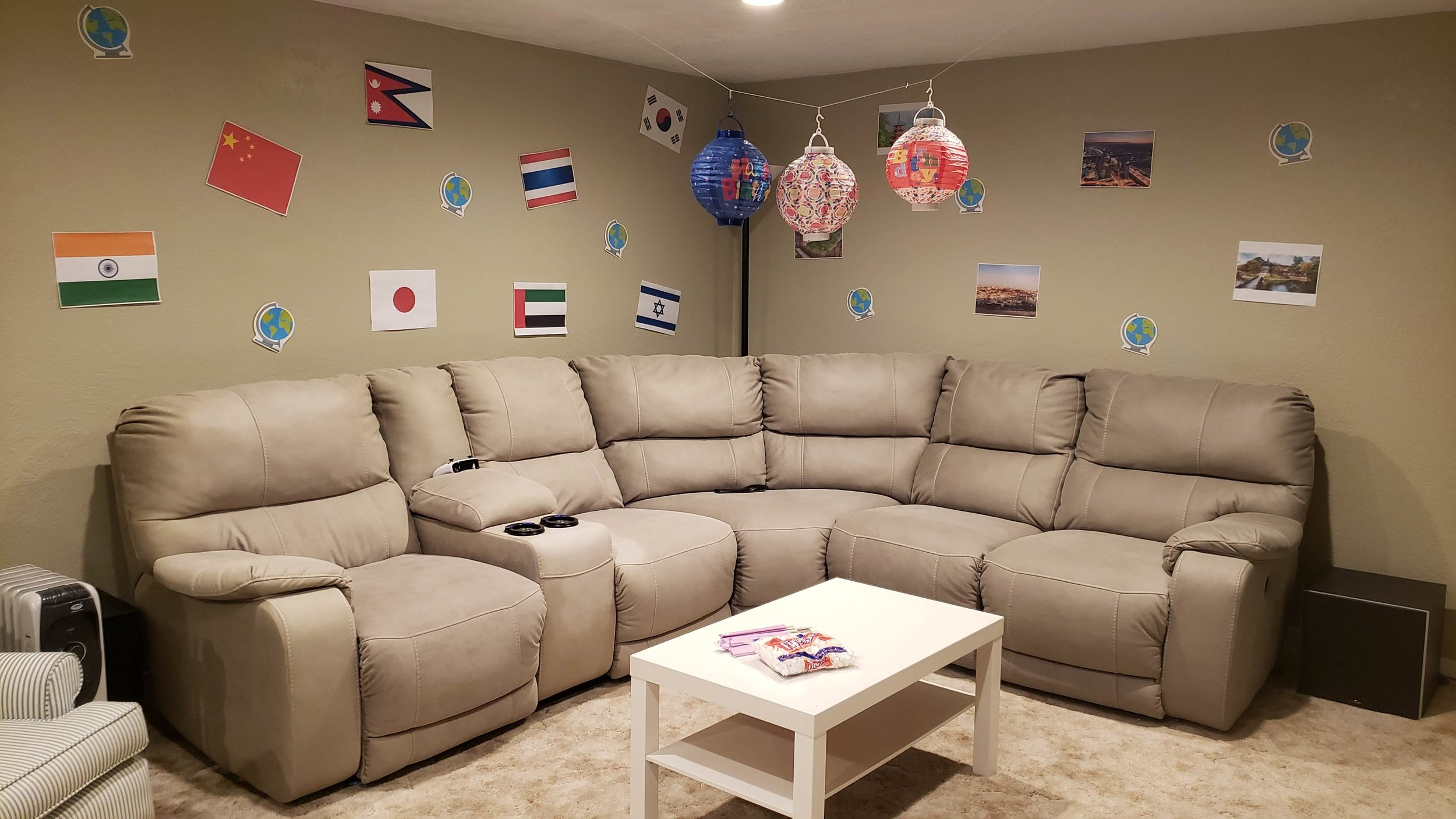 Welcome to our theater room — err, I mean, Asia! We bought the paper lanterns at Dollar Tree and I printed off flags of different Asian countries to display around the room.