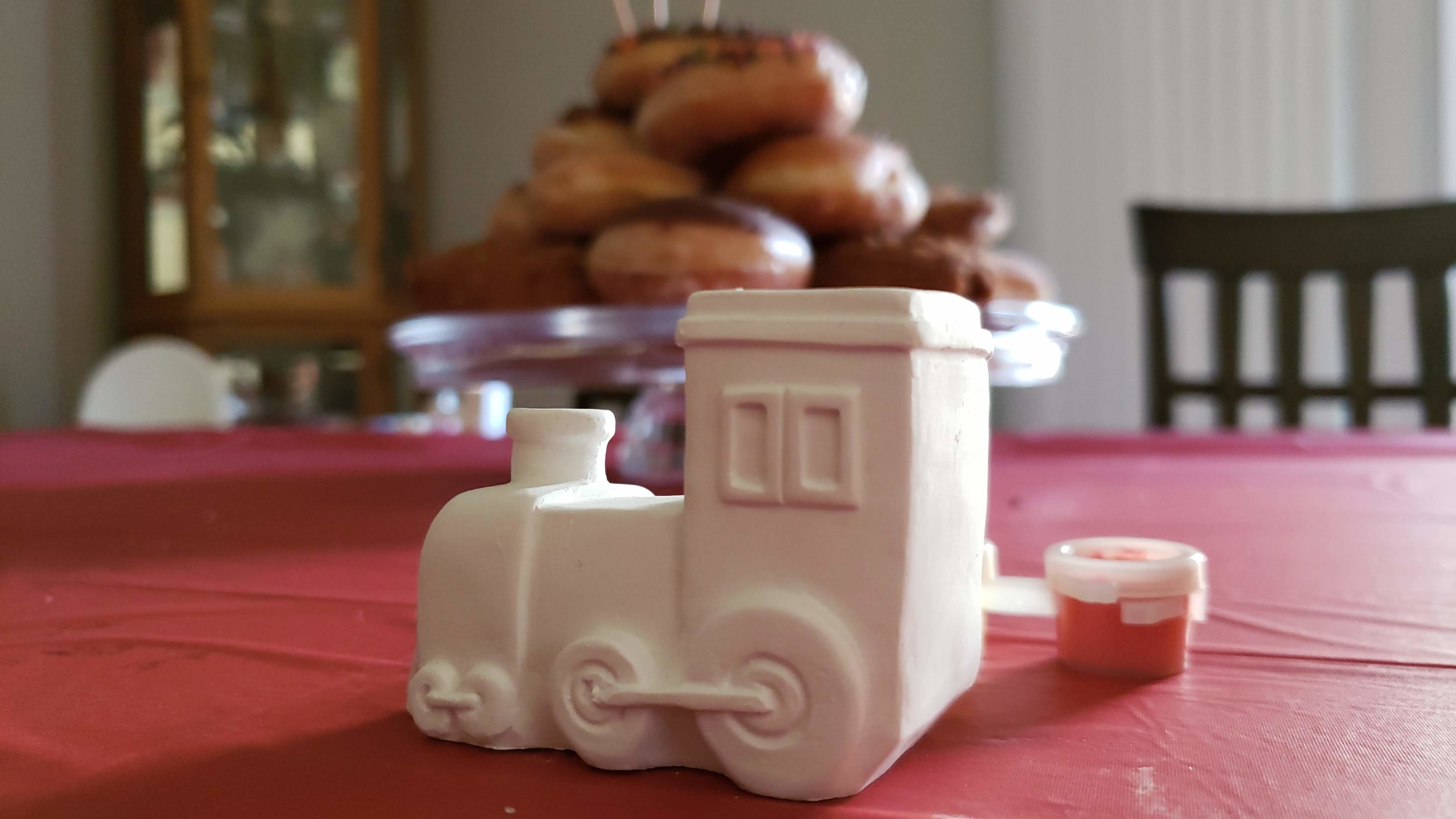 """Since my two-year-old is obsessed with trains, we called it a """"Chugga Chugga Two Two"""" party and gave each guest a Dollar Tree craft and then screened a Thomas the Train movie downstairs."""