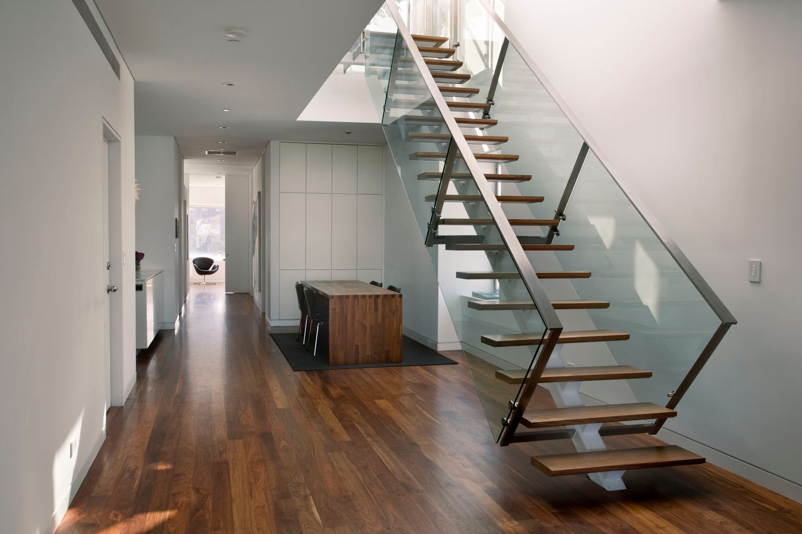 Loci 20: Week 8 - November 16, 2018In Week 8, we look back at one of our favorite residential projects: Loci designed the complete renovation of an East Village penthouse and created a new private roof terrace. Walnut and honed bluestone floors were installed with custom Danish cabinetry and furniture to create a restrained modern aesthetic. Large windows and a skylight above the stainless steel and glass stair allows daylight to illuminate the penthouse interior while creating a link to the terrace above.