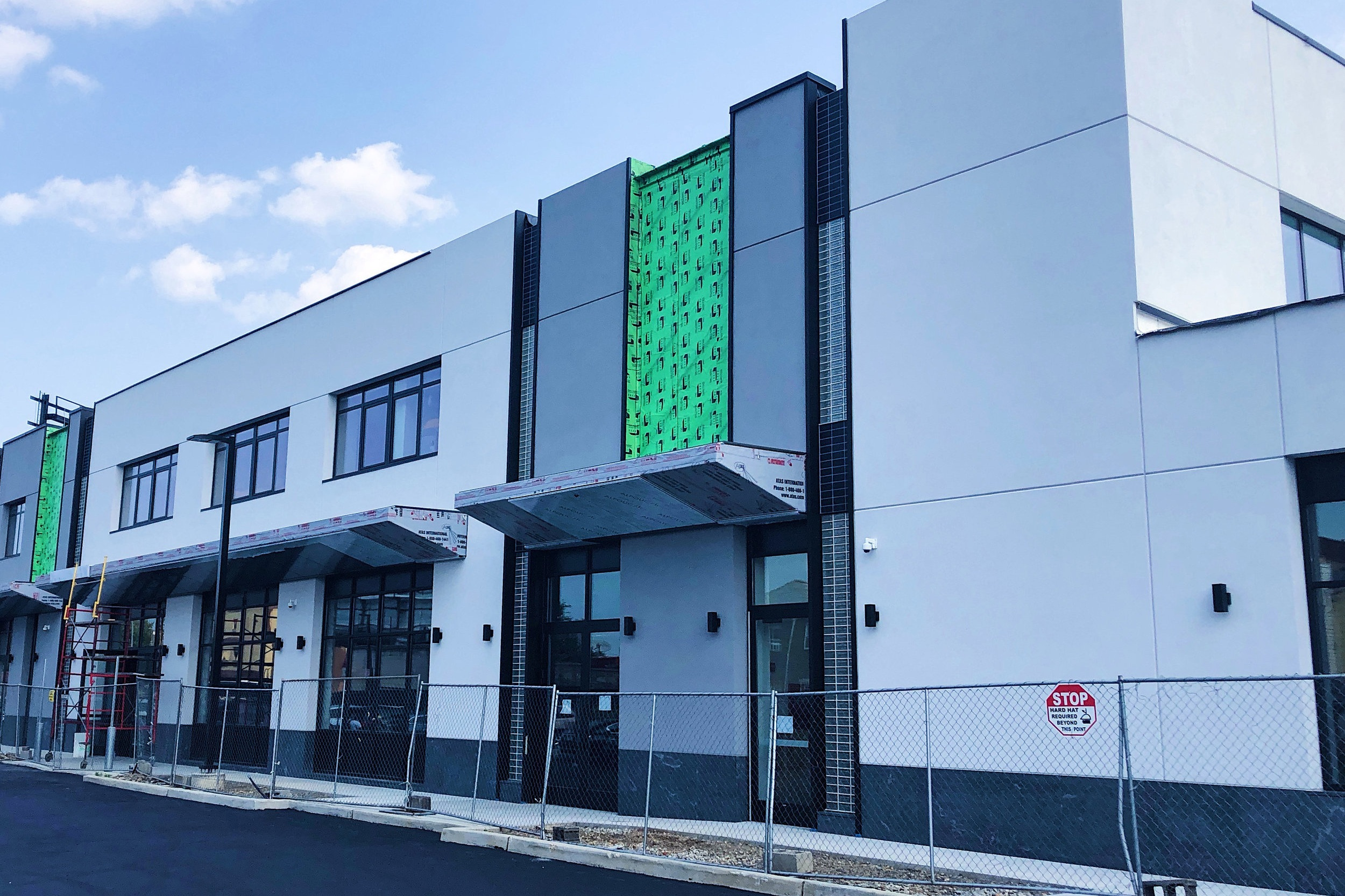 Exterior Renovation in Queens Nears Completion - August 23, 2018The transformation of this former warehouse in Jamaica, Queens is nearing completion. The new, energy-saving facade system incorporates EIFS, architectural glass block, a porcelain tile-clad rainscreen, and metal panel canopies designed to minimize thermal bridging. The building will serve the local community as a retail and commercial office complex.