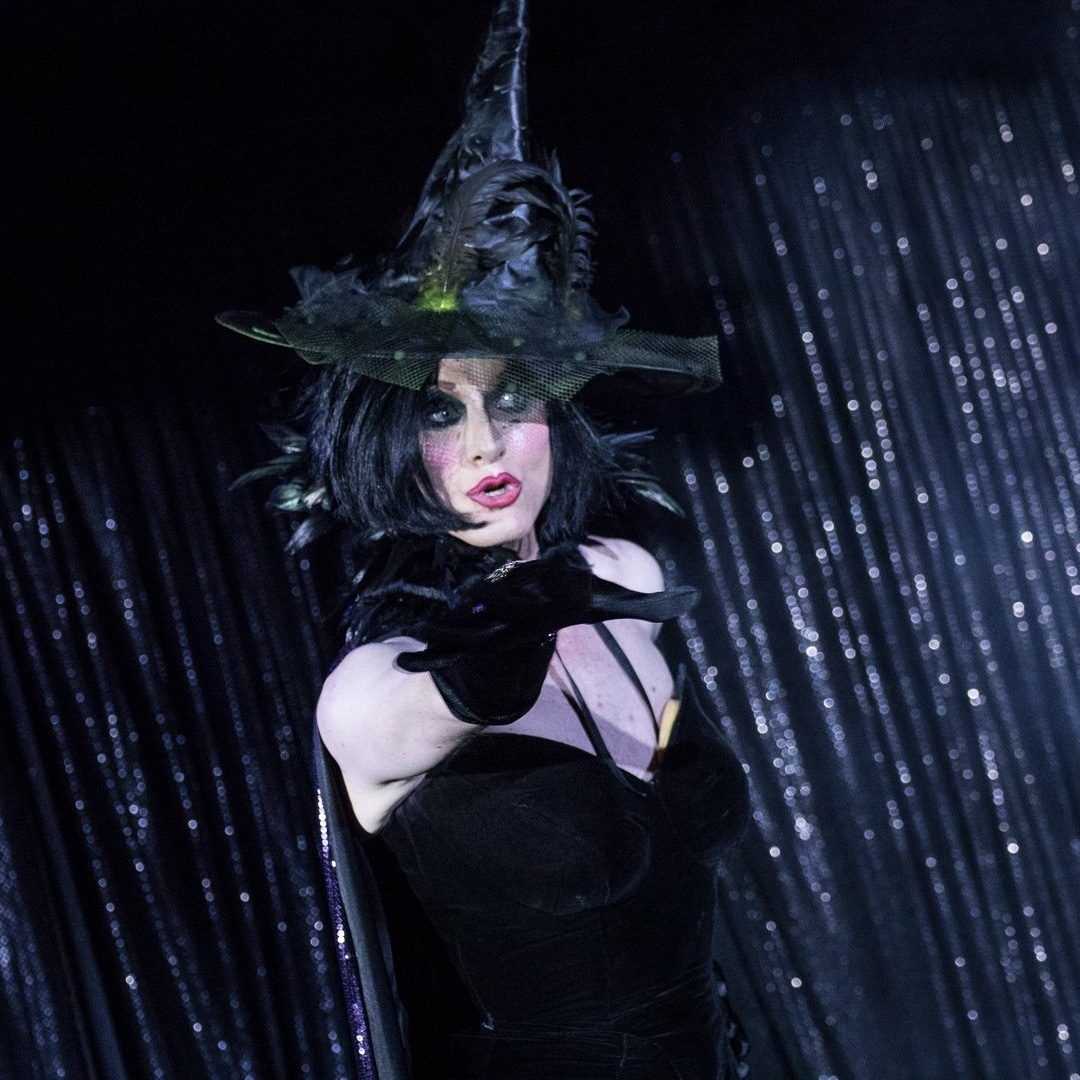 Minnie Cooper as the black witch.