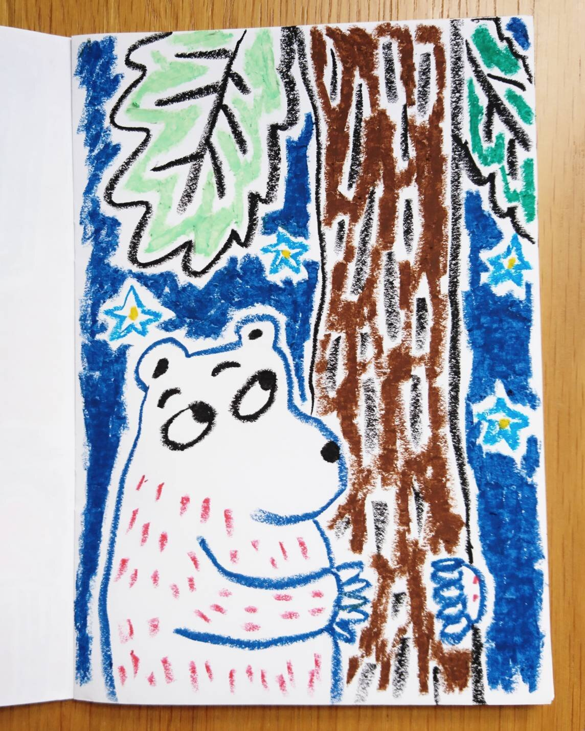 A polar bear hugged a tree.