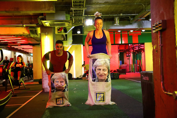 SIMON DAWSON / REUTERS  Gym members jump in sacks containing an image of Britain's Prime Minister Theresa May during a Brexfit gym class.