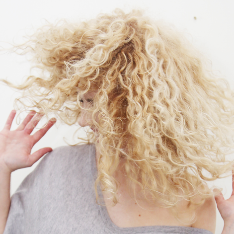 woman with frizzy curly hair.png
