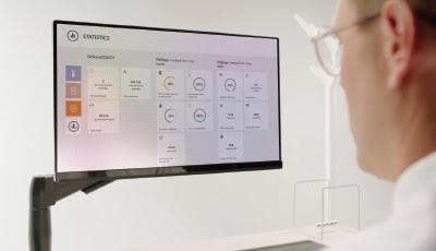 man viewing data on screen.jpg