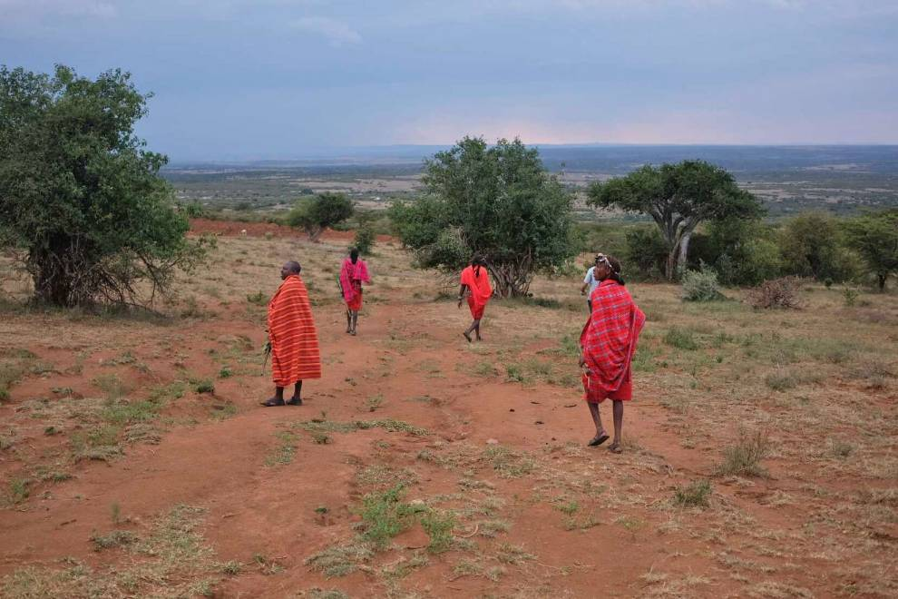 Maasai warriors show the team some of the indigenous plants they hope to monitor and protect. © Megan Laws