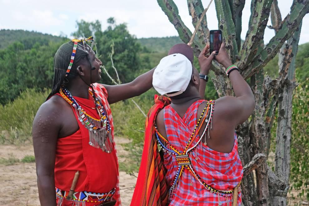 Two Maasai warriors photograph an Olpopongi tree ( Euphorbia Candelabrum)  © Megan Laws