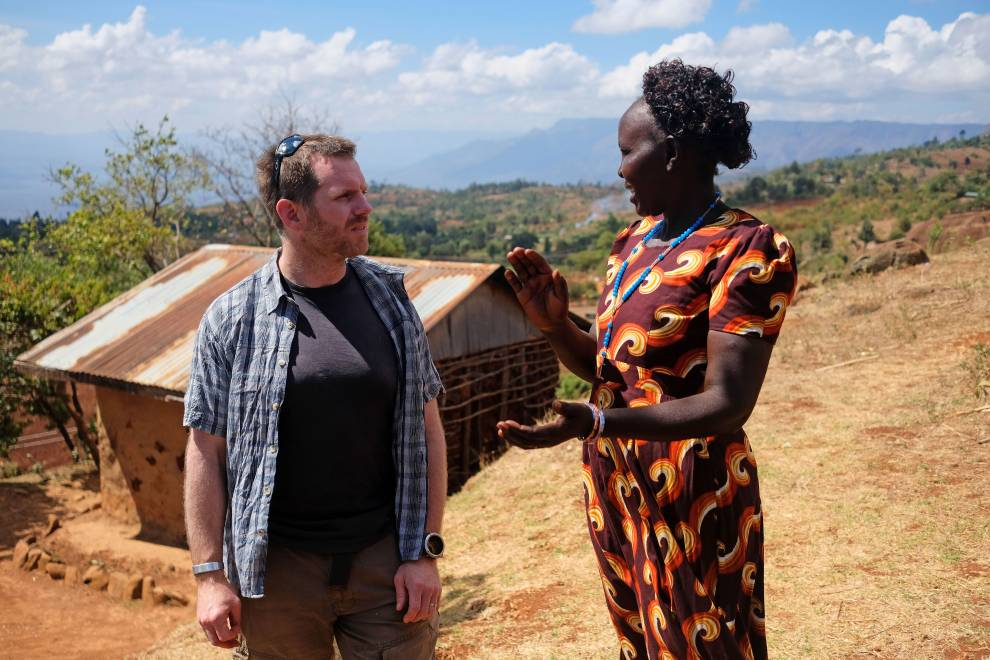 Dr Matthew Davies speaks with a local farmer in the Hanging Valley. © Megan Laws