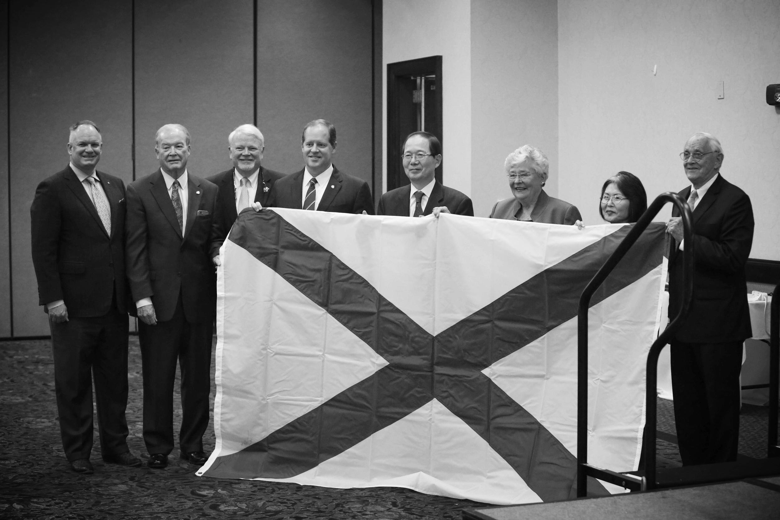 Holding the Alabama flag