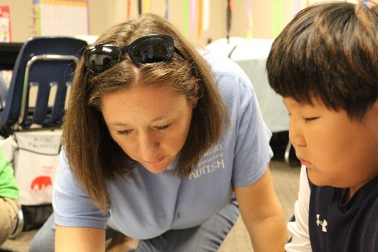 Mrs. Elisabeth Newell with special needs student, Seongmin Choi