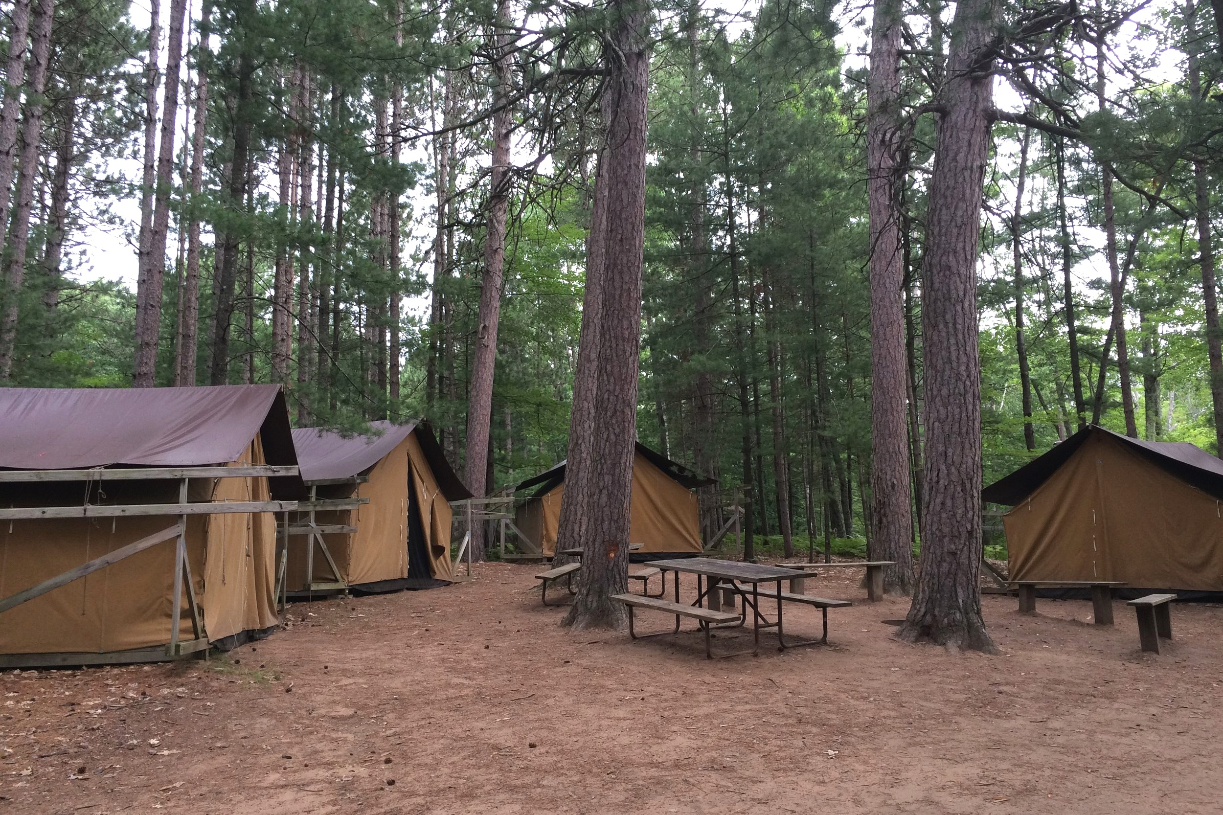 Tent Villages - - Consists of four army-style platform tents, each containing two bunk-beds