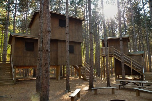 Treehouse Village - - Each treehouse has four rooms which each contain one bunk-bed- Located in a pine forest
